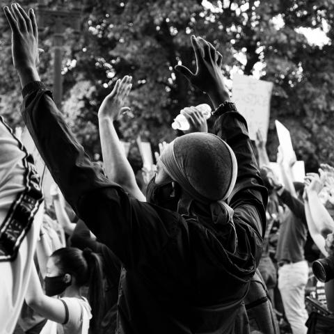 BLM protesters in Washington, DC, raise hands in the air, June 2020.