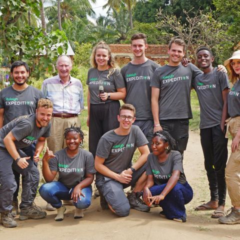 Laidlaw Scholars in Tanzania stand with Lord Laidlaw