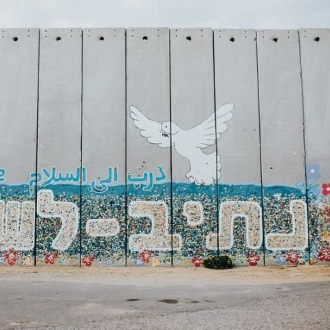 barrier wall with peace dove grafiti